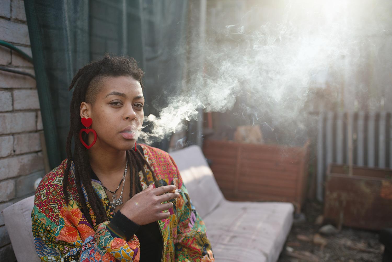 Serwah smoking in the backyard, Sydney, 2016