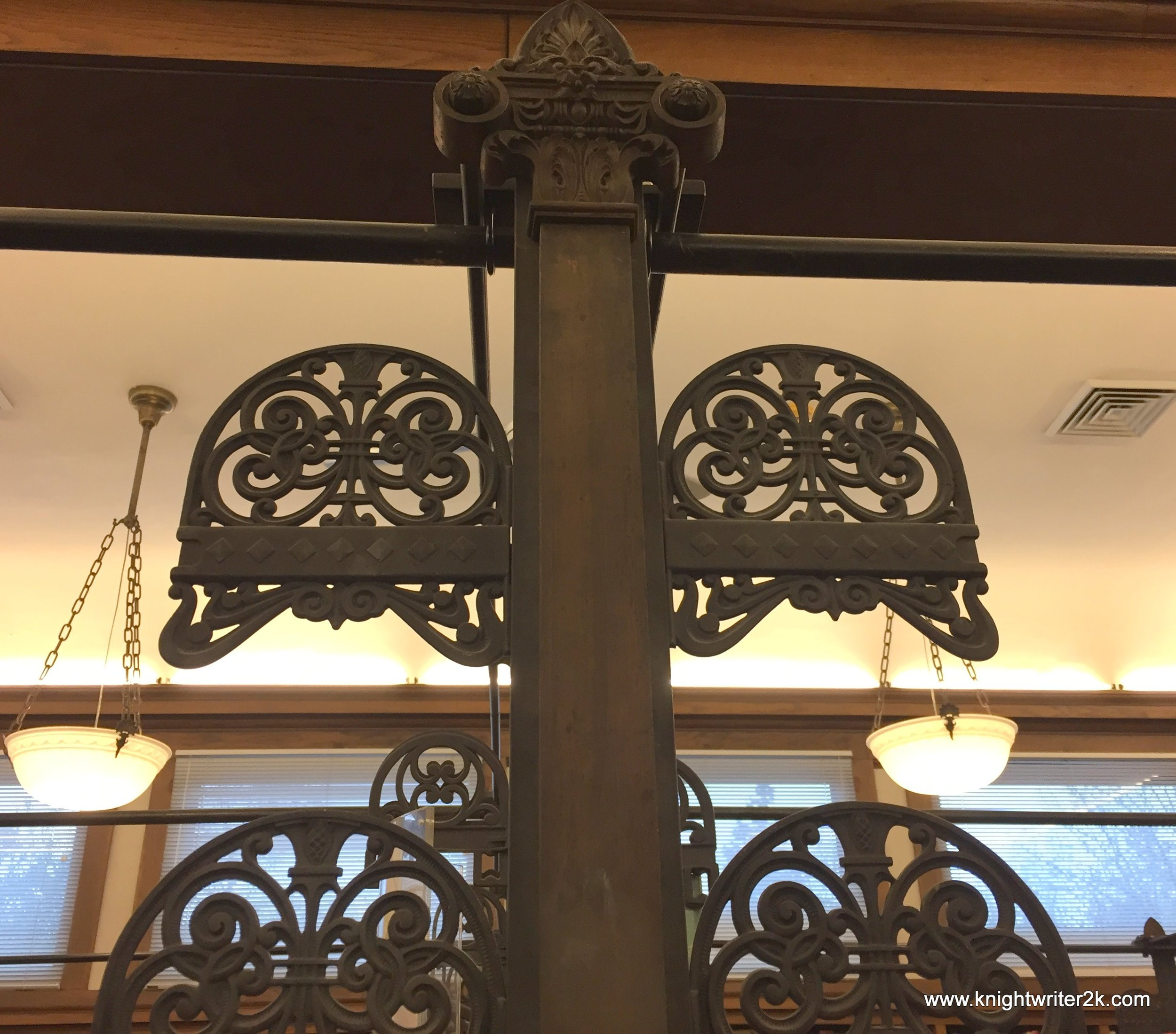 Iron scrollwork from original shelving circa 1890's
