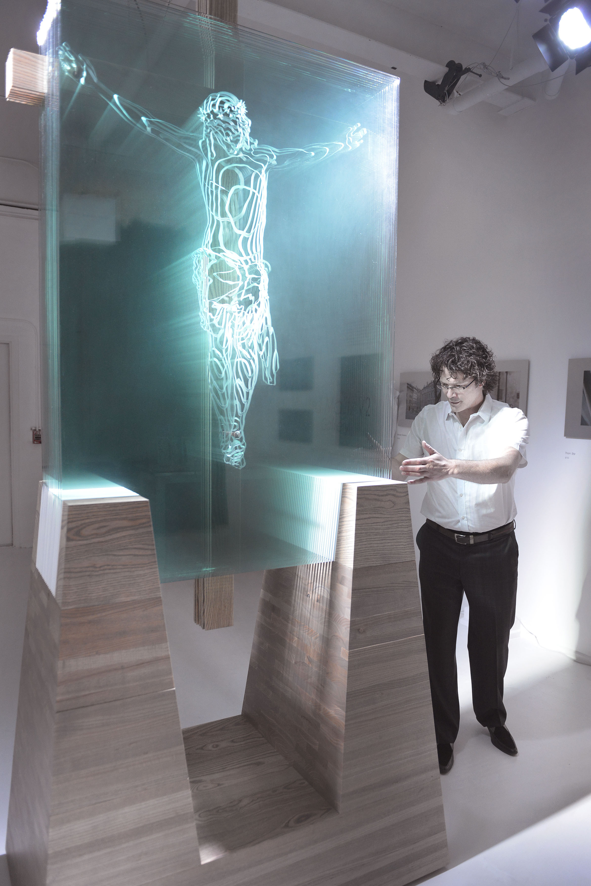 Front view showing sculpted glass and halo of light along the left side of His body.