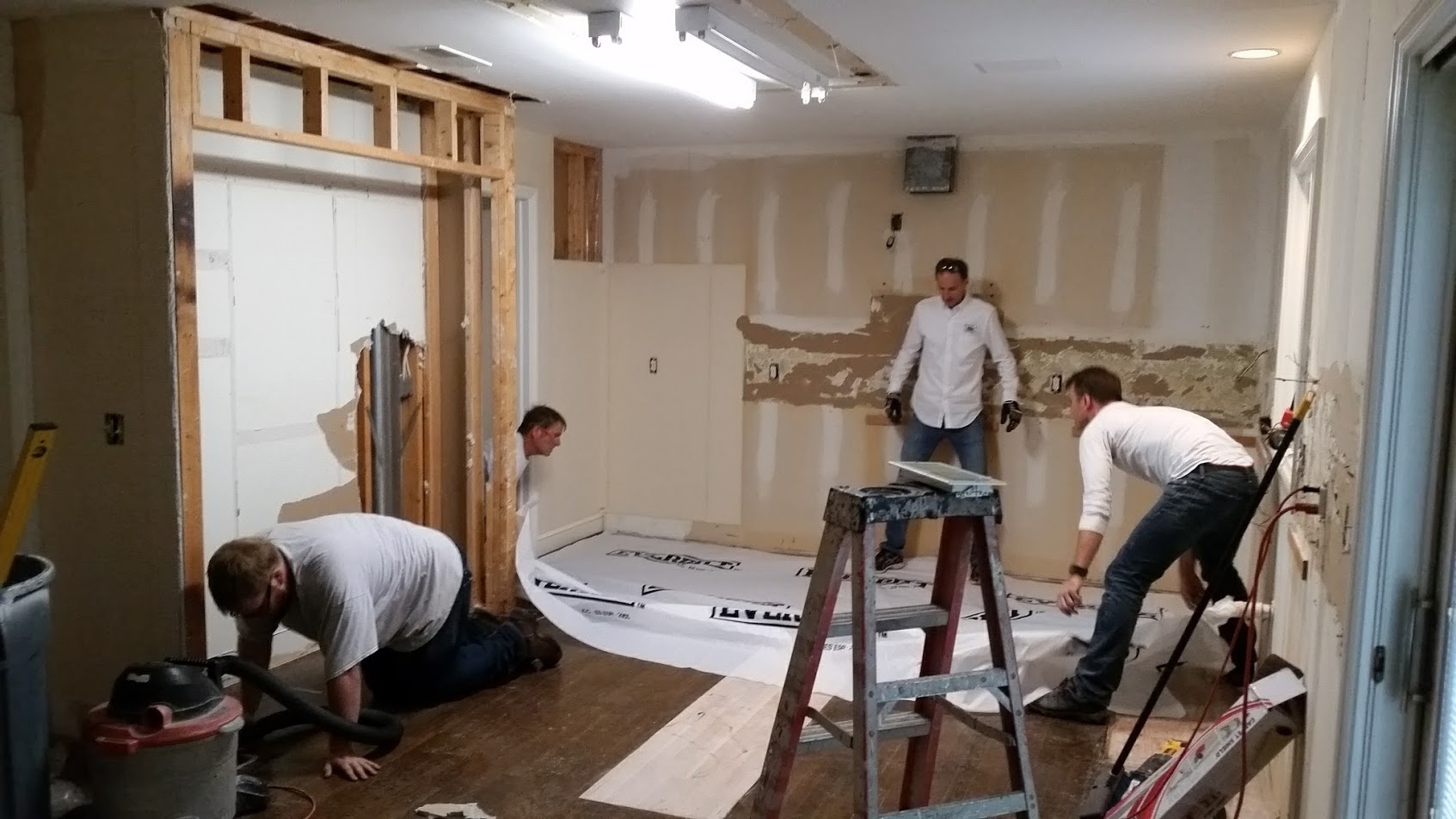 Valle Crew laying floor protection