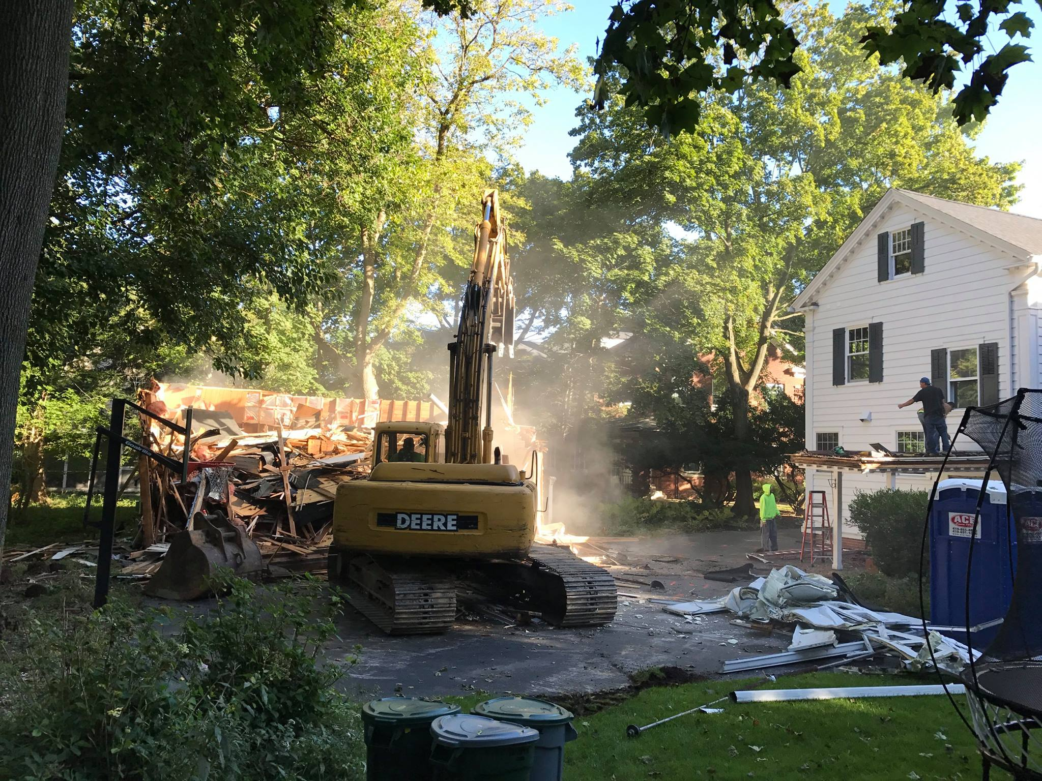 Demo crew making short work of the remainder of the garage and clearing the site for the addition.