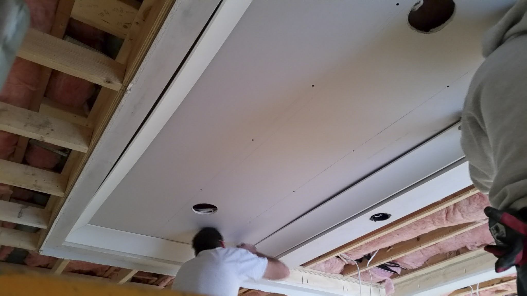 Coffered ceiling secured to ceiling framing. Securing crown molding and drywall panels.