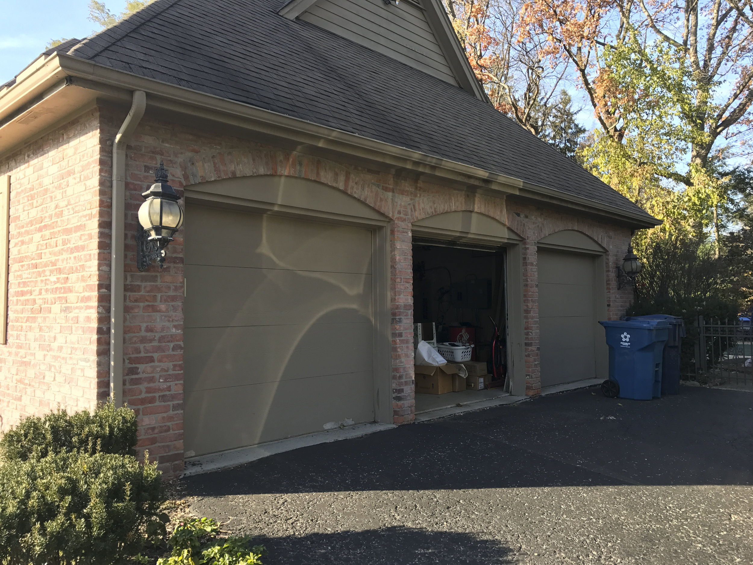 Garage before. Framing between the two doors on the left side of the frame will be removed to create one large single door.