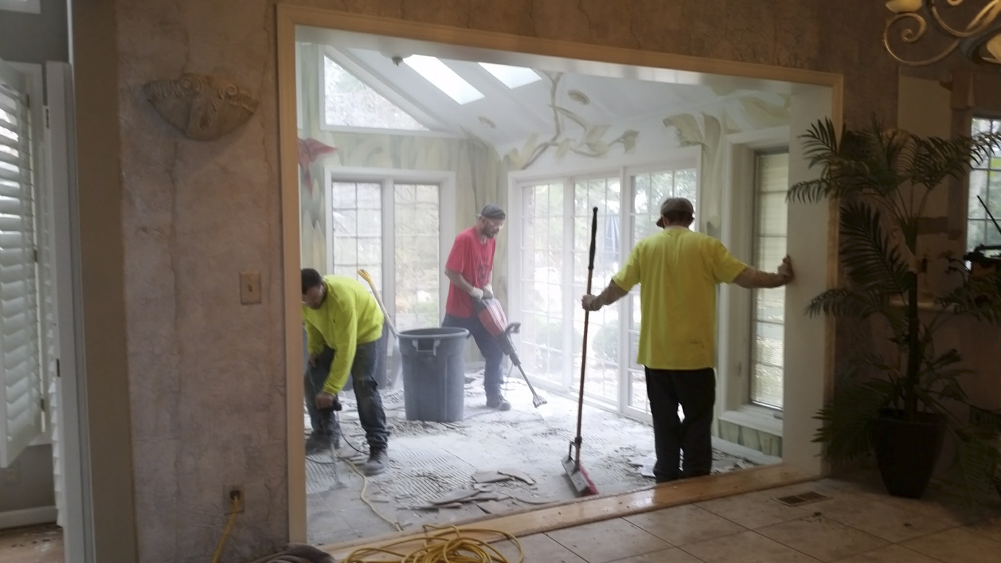 Mike's Hauling demo crew hard at work demoing the sunroom floor. Thanks for all your hard work!