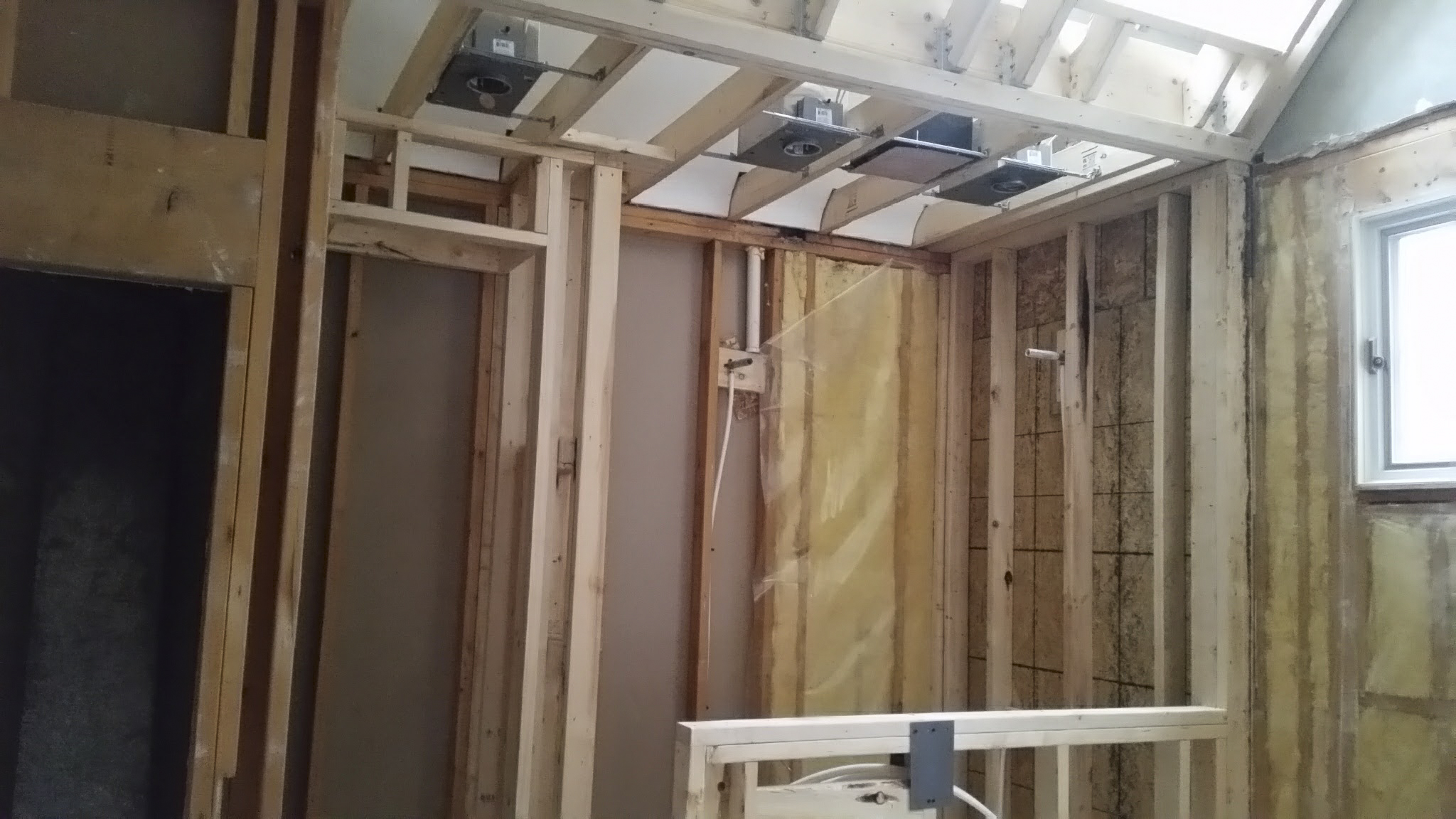 Shower ceiling and skylight framing done. Electrical work in progess