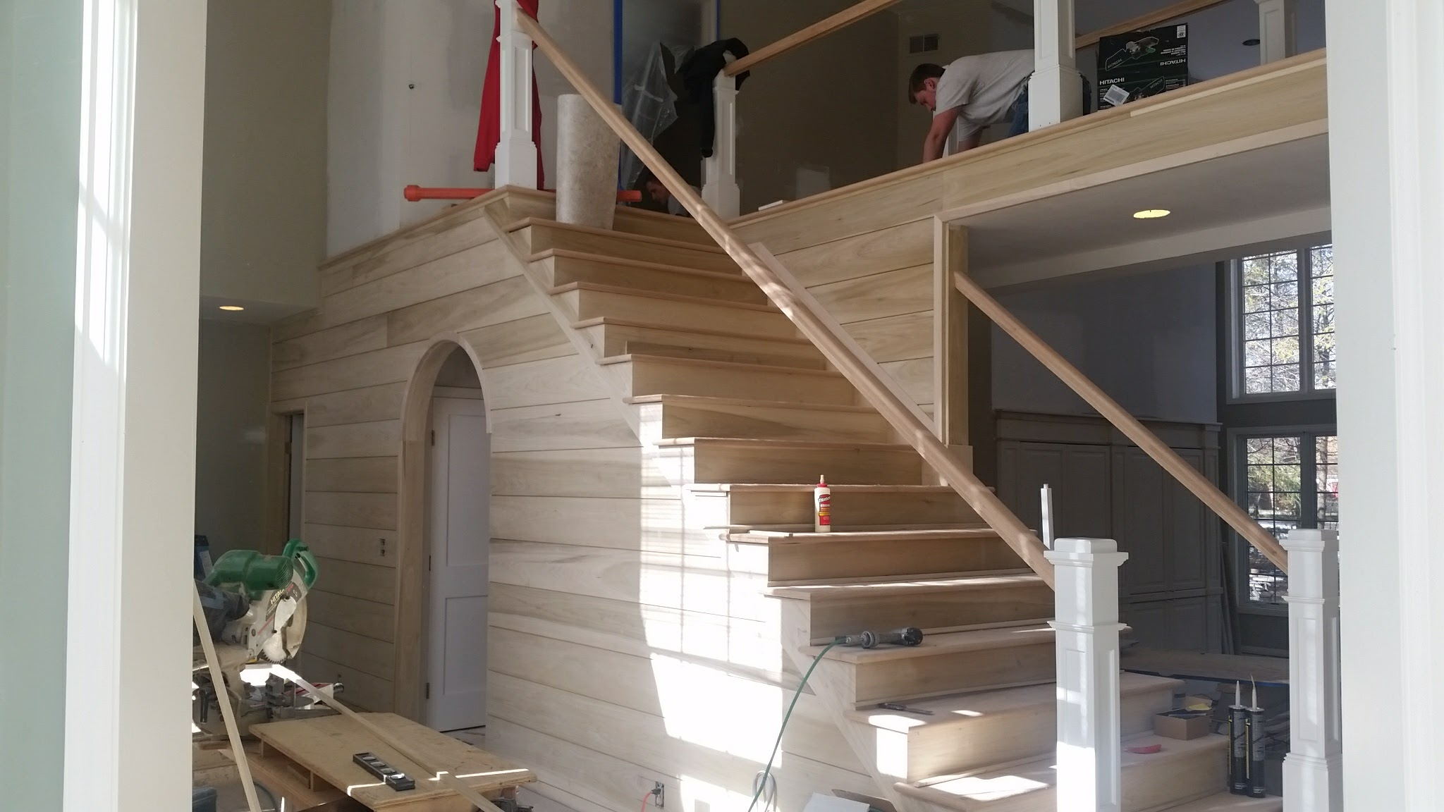 Shiplap foyer and stairwell walls with open-tread stairway sanded and fitted.