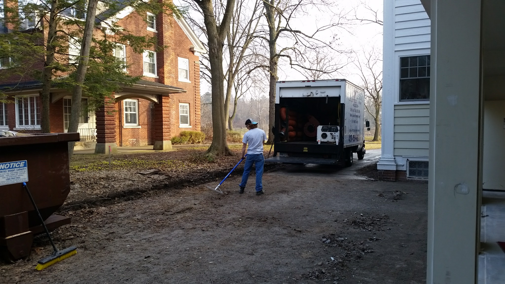 Clearing driveway of roofing and siding debris