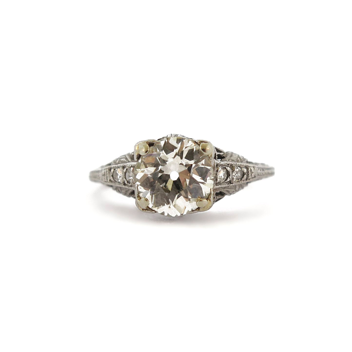 Edwardian Diamond and Side Stones Filigree Platinum Ring