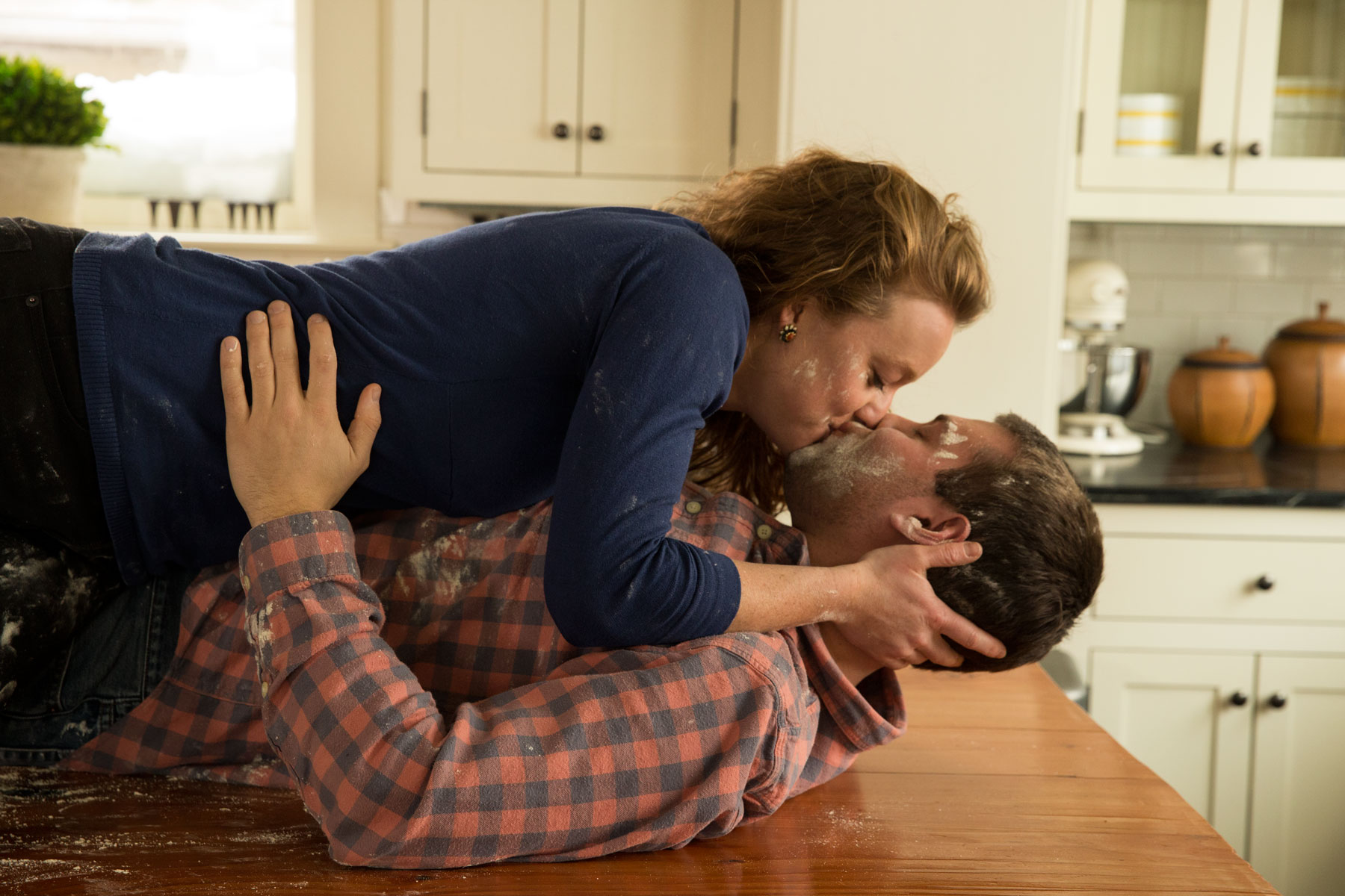 Couple_Kissing_Kitchen_George_Lange_Lifestyle.jpg