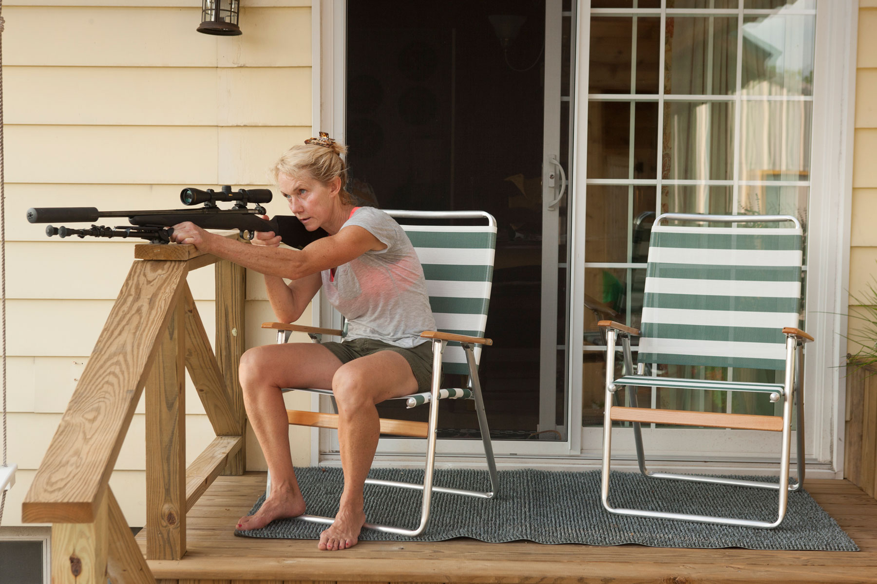 Woman_Shooting_Gun_George_Lange_Lifestyle.jpg