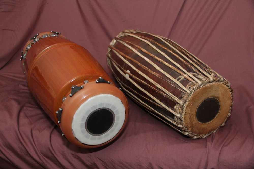 SRI mridangam (left) produces the tone of the traditional mridangam (right) without the use of wood or animal skins Image: Author