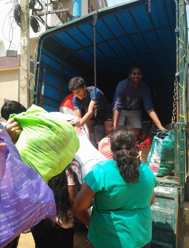 Loading the truck to Goonj