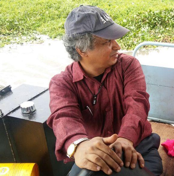 Prof Ramachandra inspects the lake