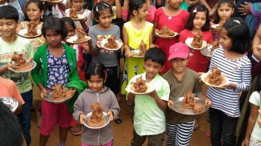 Participants of a clay Ganesha workshop