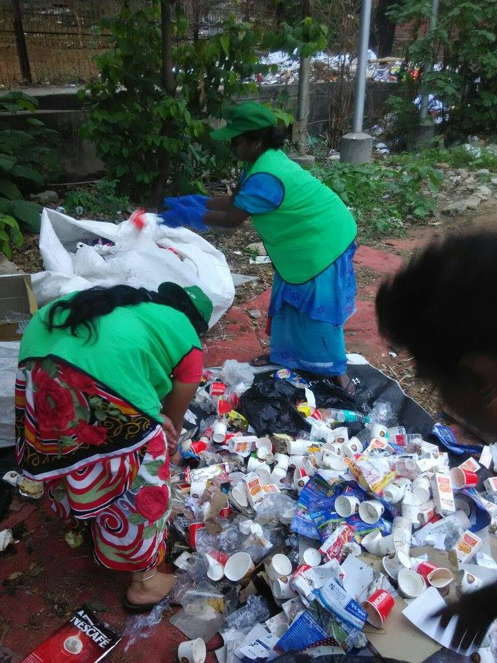 Hasiru Dala staff sort segregated dry waste at the TCS Marathon Image: Facebook/ Hasiru Dala