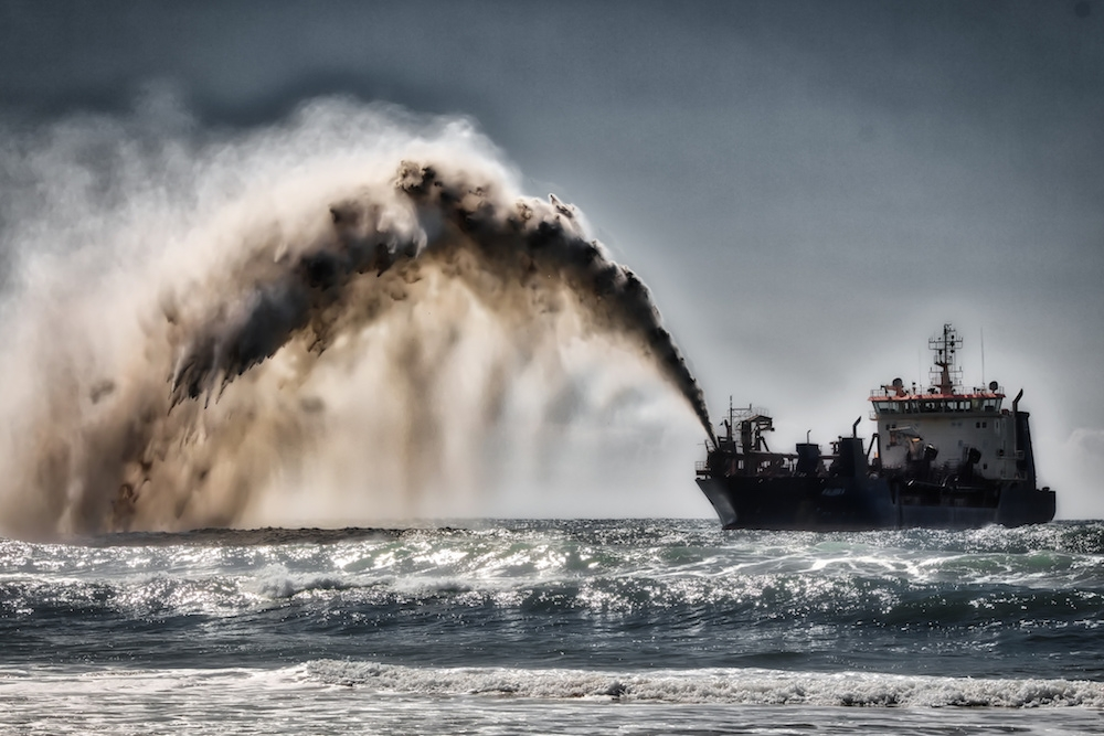 Sand being deposited as part of a beach nourishment project in Gold Coast, Australia. Image: Steve Austin/  CC BY-SA