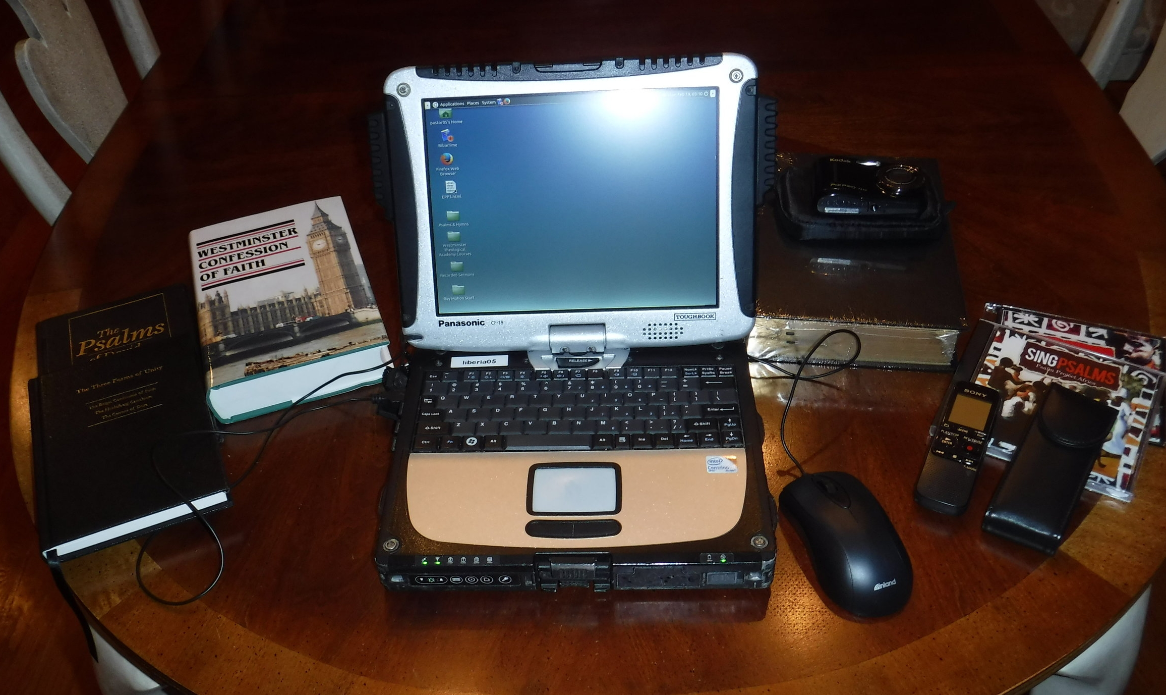 Here are the tools we are trying to put into the hands of every Pastor we are working with. A Panasonic Toughbook computer, a Reformation Heritage Study Bible, the Westminster Standards, the Three Forms of Unity, a Psalter, Sing Psalms Africa CDs, a Sony MP3 Recorder, and a Camera.