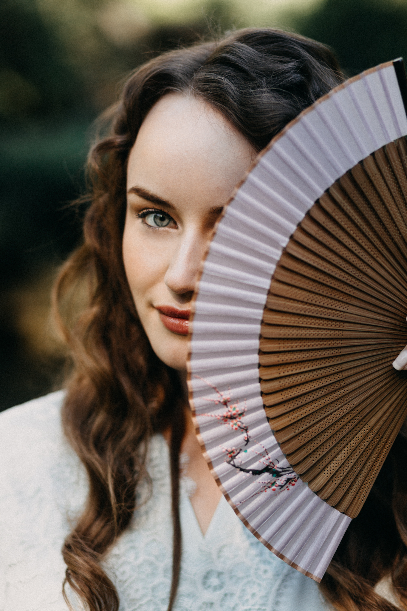 bride with japanese fan | wedding day photos