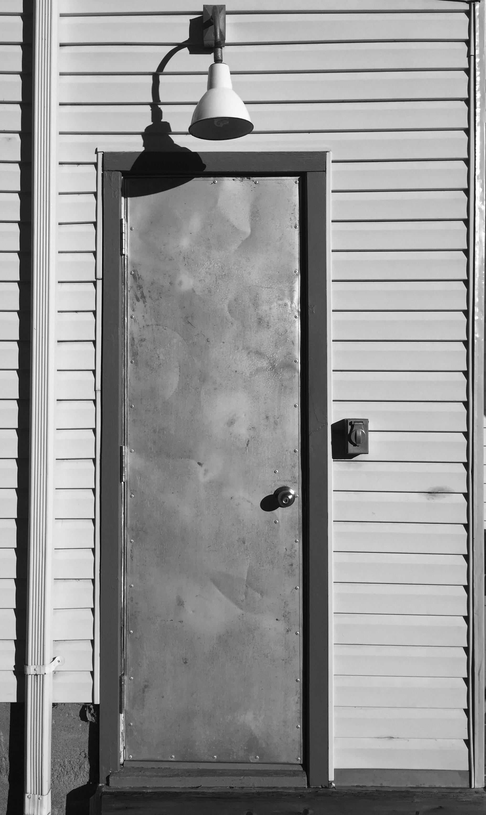 The side door to Noah Harpham's apartment.