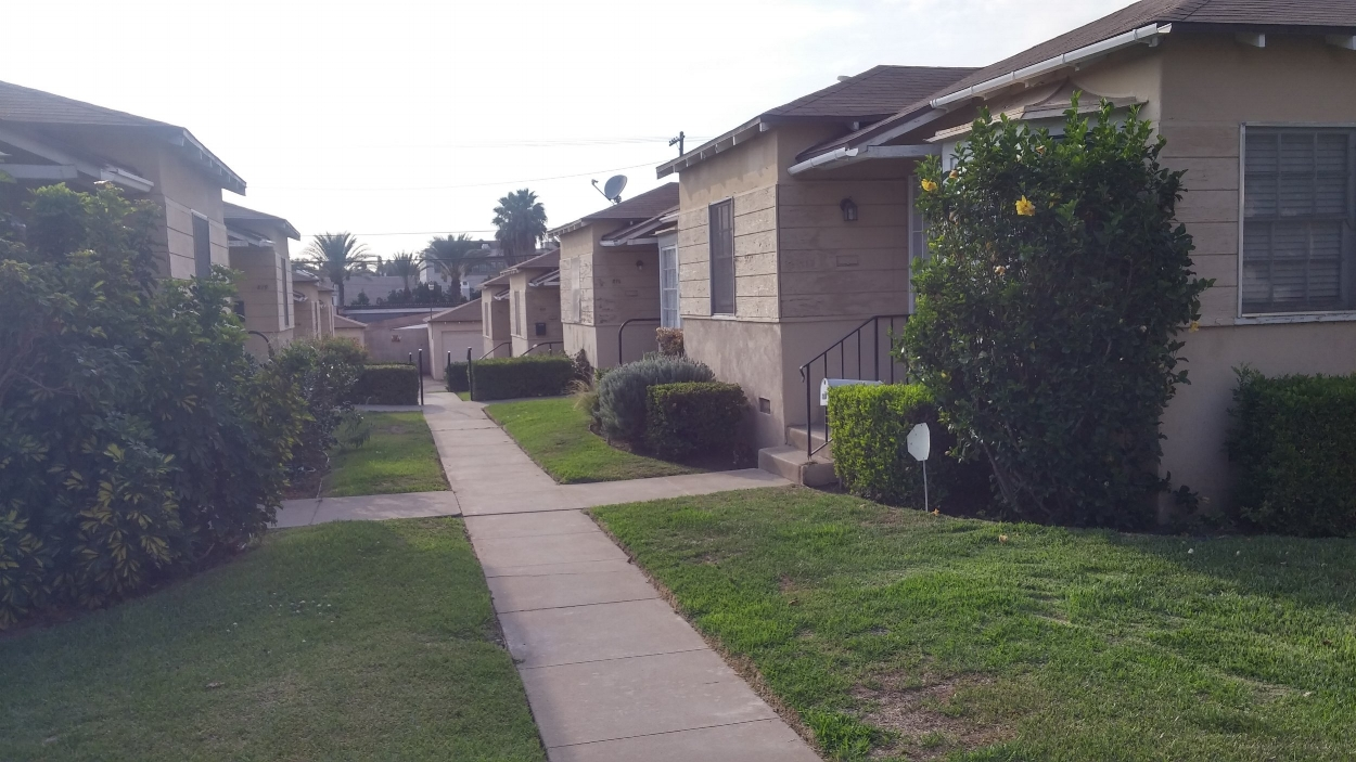 These bungalows, built in the 1930s do not show the same attention to detail and have not been kept up as well as other examples.  They still do share a common yard space, but reflect the changing attitudes in contemporary style of the time.