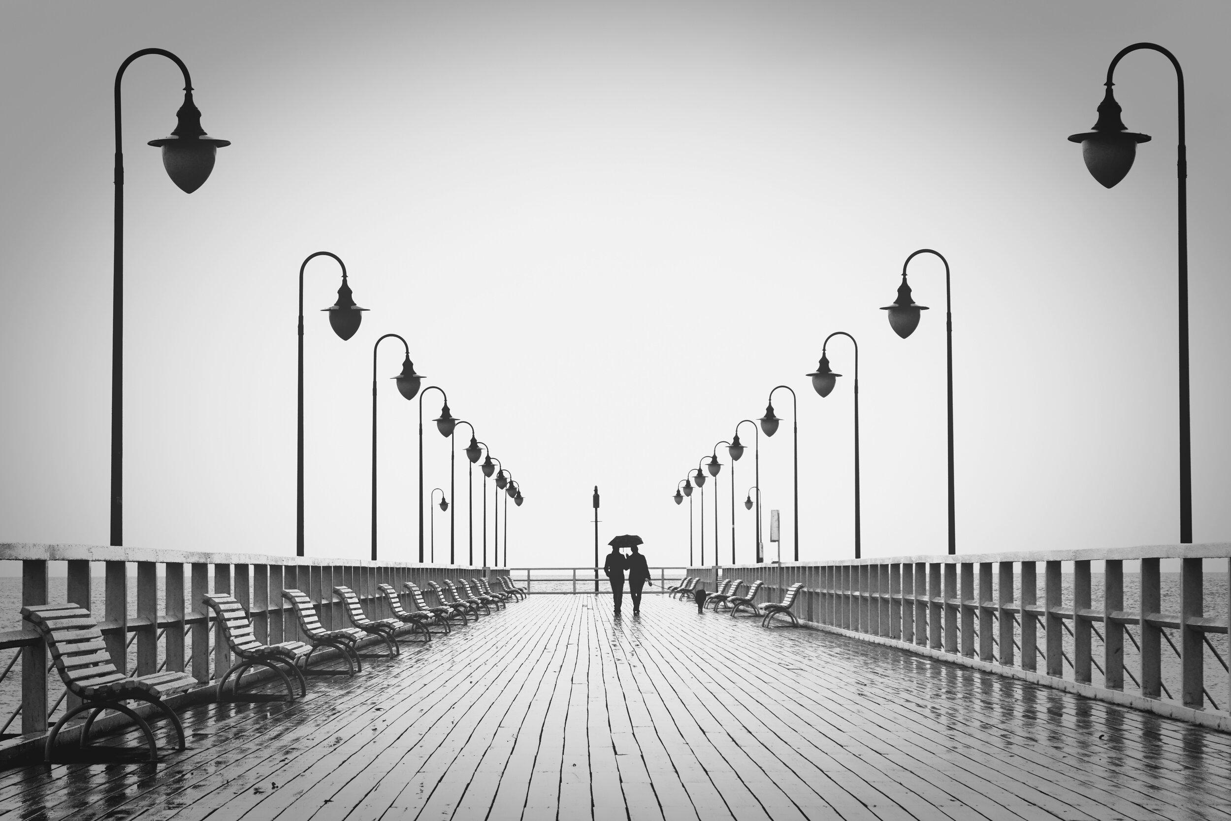 benches-black-and-white-boardwalk-220836.jpg