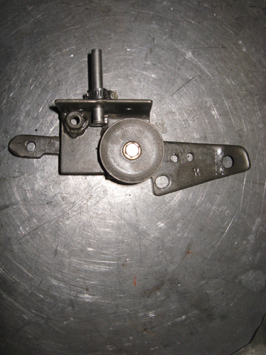 We had to fabricate this pulley bracket to make the reverse pull of the linkage work.