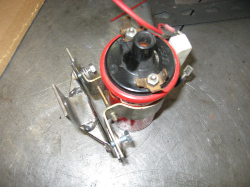 Here is a coil mounting bracket we had to fabricate from a stock type 3 coil mount and some angle iron to be able to hang a coil from the engine.