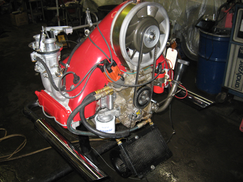 Here is the engine, ready for a test run. At first, it back-fired and spit flames up through the carb velocity stacks. I finally realized I had forgotten to install the idle jets (late one December evening) when rebuilding the Weber 40s! Some 55 size jets made everything much better, but still very loud with those dual cannon chrome zoom tubes!