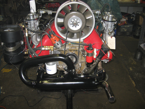 With the muffler finished and the whole system covered in high temp paint, the engine is surprisingly a LOT quieter. Even a noisy glass pack muffler is more silent than the dual cannon zoom tubes from hell. I will make a note here, that this exhaust system is NOT the ideal for a type 4 engine; especially anything high performance. This set up was done within the constraints of time and money available. An equal length tube system and better collector would give cooler running temps and more power from the engine. This is however, a stock engine, so it will run well in this form. Derek's type 4 is ready for his next project!