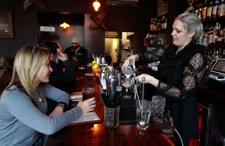 Photo: Michael Macor, The Chronicle -Michelle Tolbert, (left) enjoys a beverage at the Dogwood bar in downtown in Oakland, Ca., as bartender Irene Franzen prepares a drink on Friday Jan. 13, 2017.