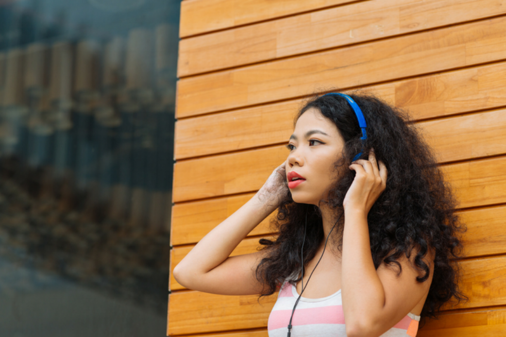Woman with headphones (1).png