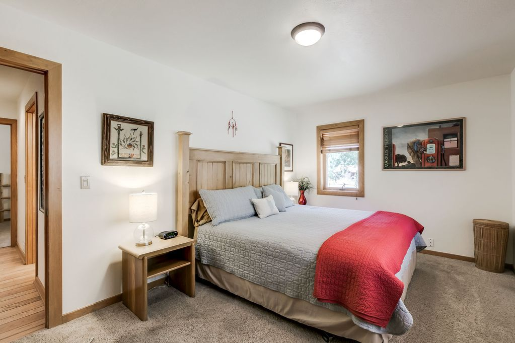 1st Floor Guest Bedroom with King Bed   Views of the garden and red rocks.  Shared bathroom, toilet & shower.   $1650 for one person or $900 each for 2 people    (all inclusive except travel costs)