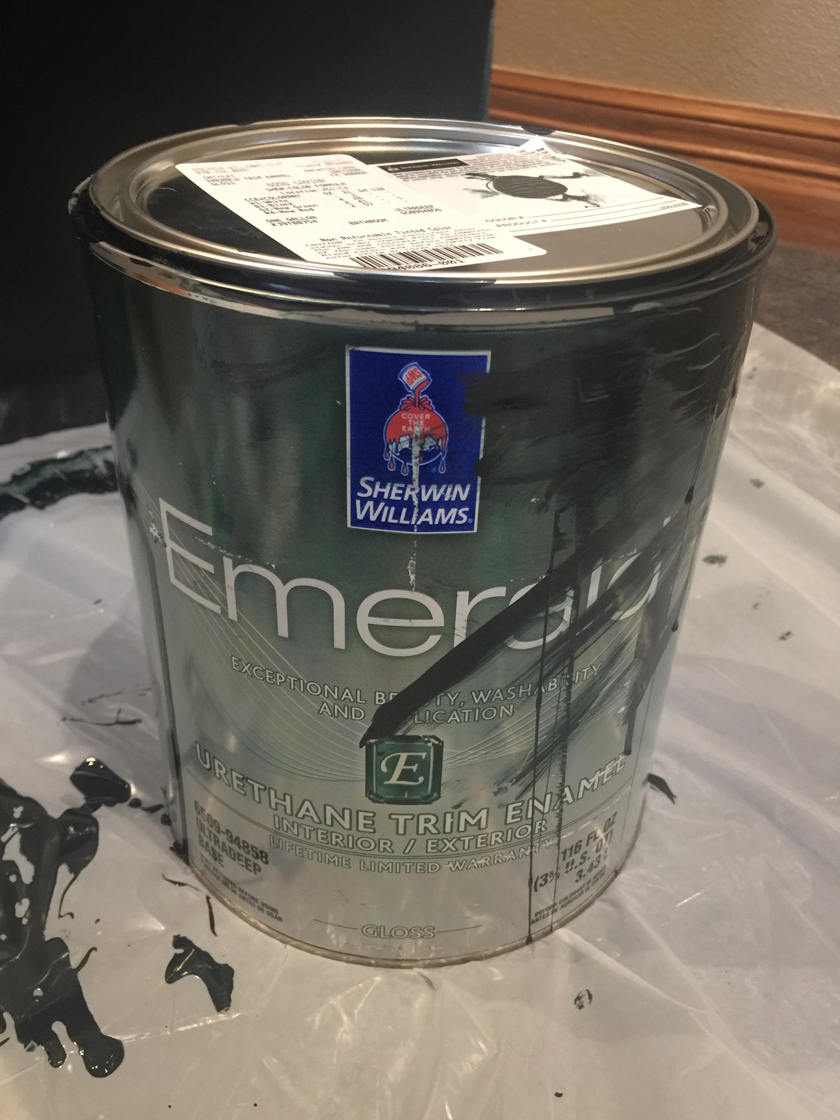 5) Paint cabinet. For this project I chose Sherwin Williams Caviar. It will take at least two layers depending on color choice. -