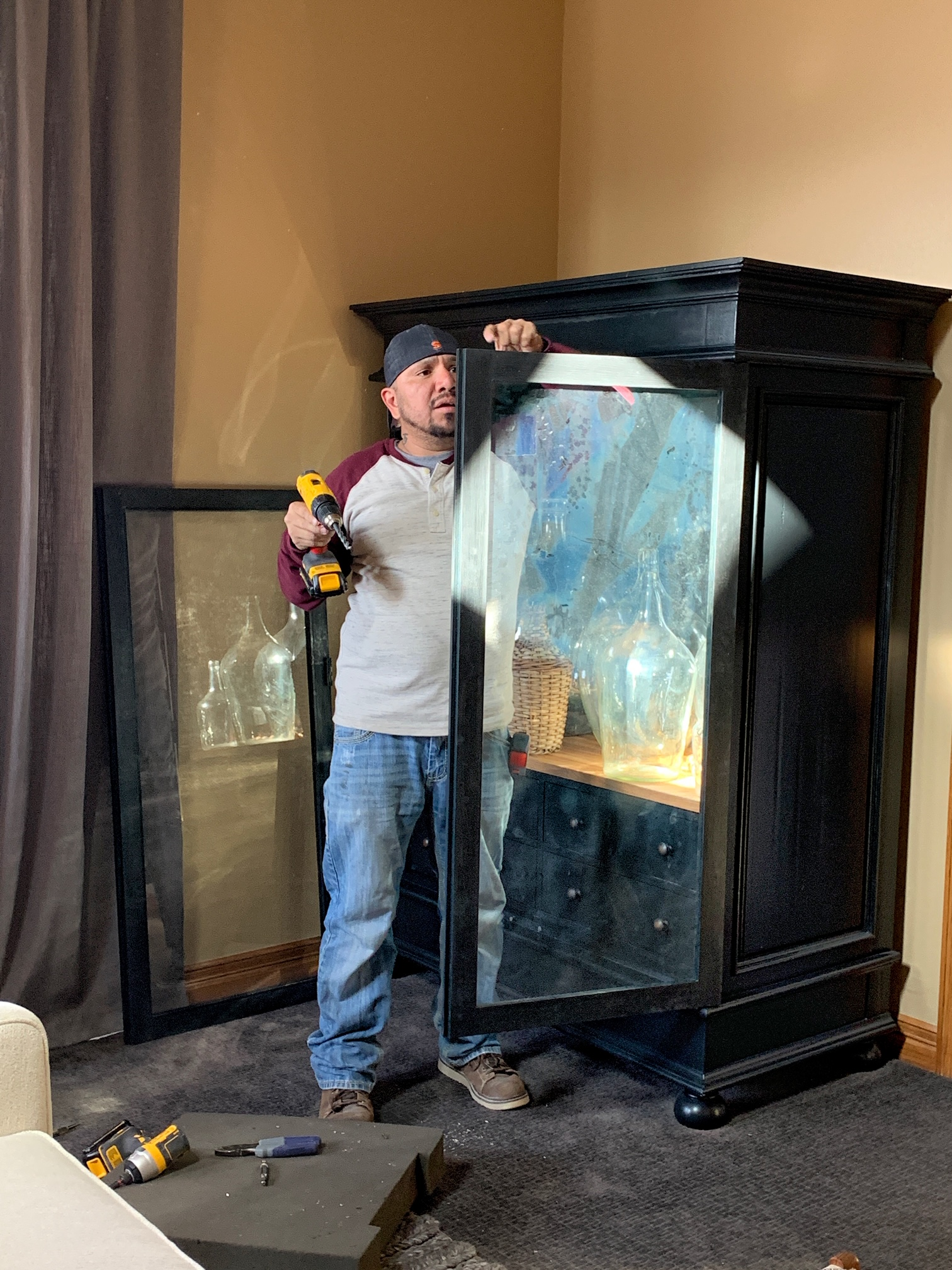 9) To achieve the wide open glass-front look of the inspiration cabinet, I had custom glass-front doors made. They even followed my painting technique to match the rest of the cabinet. - www.coloradofinewoodworks.com