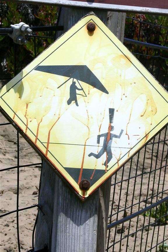 Who knew a hang glider warning sign could be a specimen of design efficiency? Just look at that pictogram. If MC Escher designed a warning sign, it would look exactly like this. I mean, a head AND an exclamation point at the same time? Inconceivable!