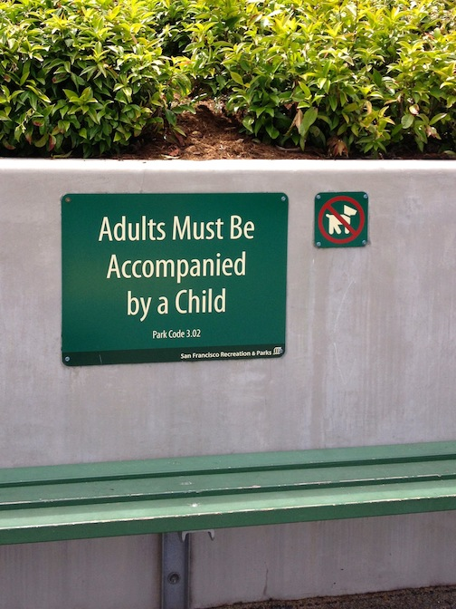 """Not long ago, this playground sign would have read, """"Children must be accompanied by an adult."""" To be sure, I'm not knocking the sign; in fact, I quite agree with it. But the fact that such a sign needs to exist is part of what's seriously wrong with humanity."""