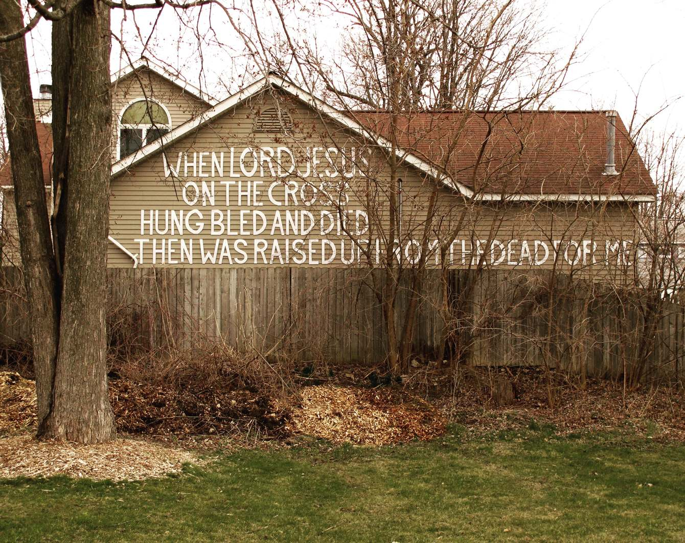 Perfectly acceptable message for a neighbor to affix on the back of his suburban house. Not creepy at all.