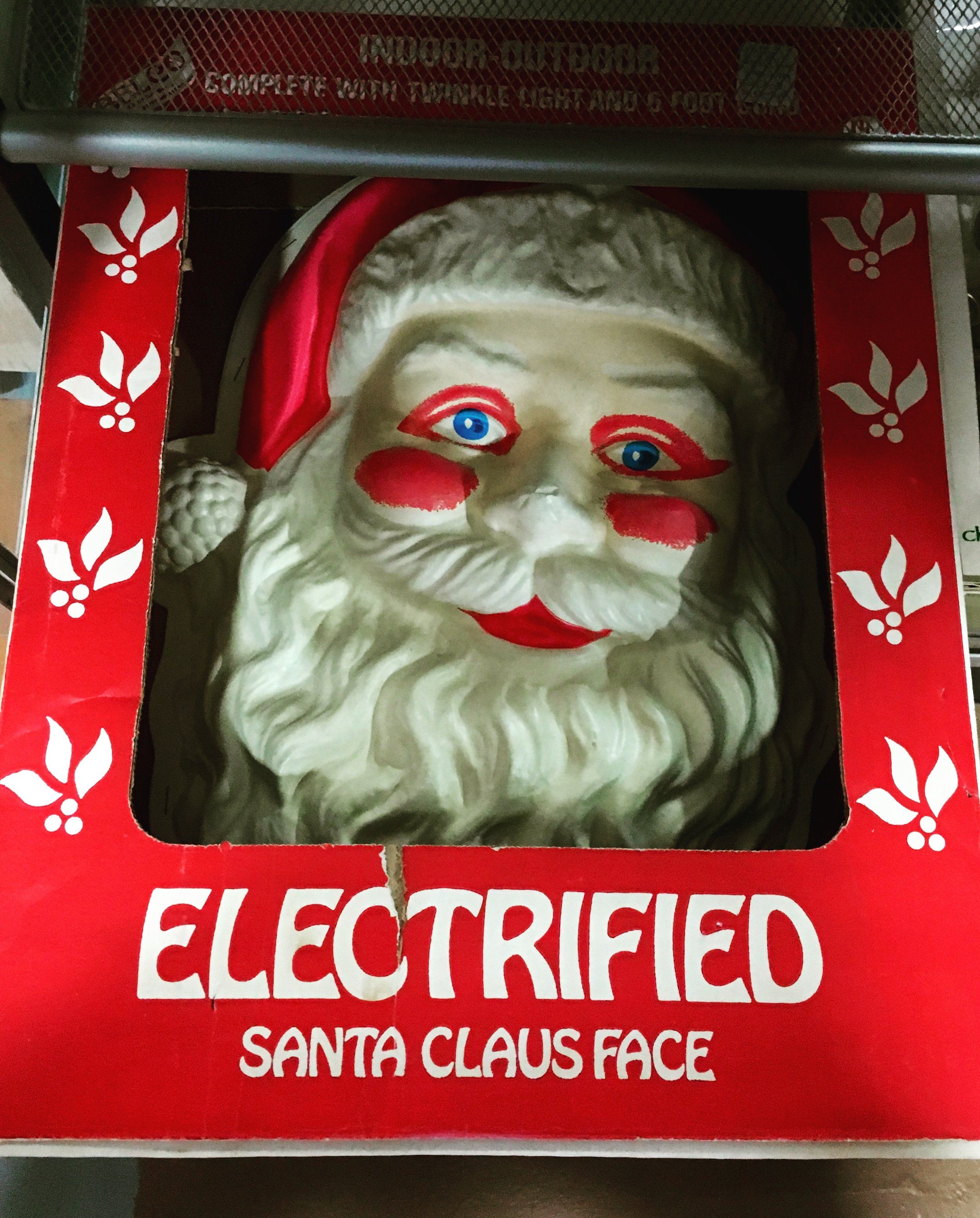Nothing rings in the holiday cheer like an anemic Santa with blood-red eyeshadow, lipstick and rosacea who's just waiting to electrocute you.