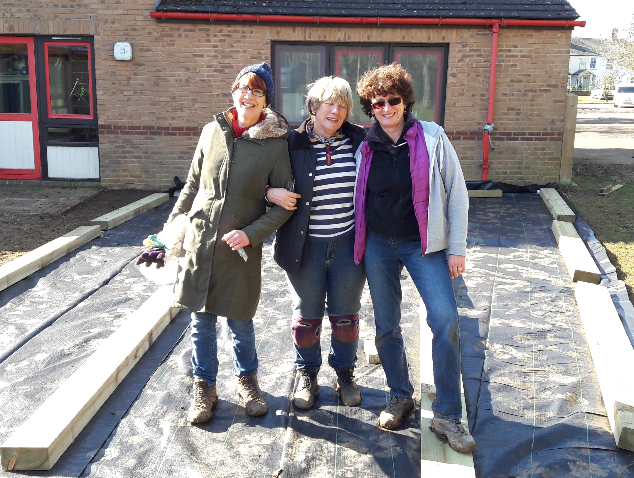 Volunteers, Annie, Steph and Diana help build the new Incredible School Garden