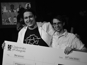 Above : Glasgow 2013 Science Slam final. Holding the giant novelty prize-cheque with  Greig Stewart (A.K.A. Theremin Hero)  who lent his laser harp for a demonstration of the photo-acoustic principle!