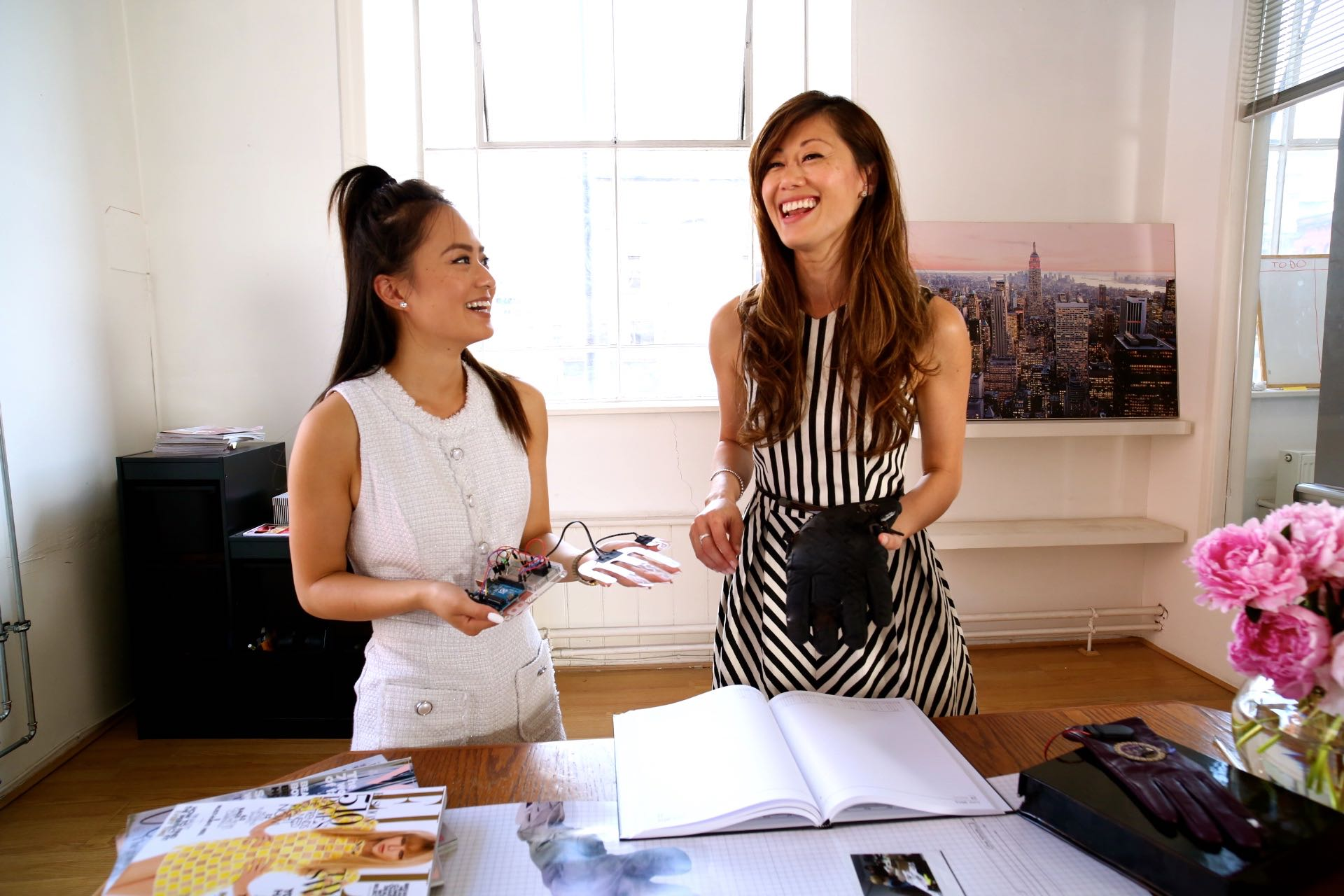 Michelle Hua and her assistant Rachael Yeung at Made With Glove Manchester office