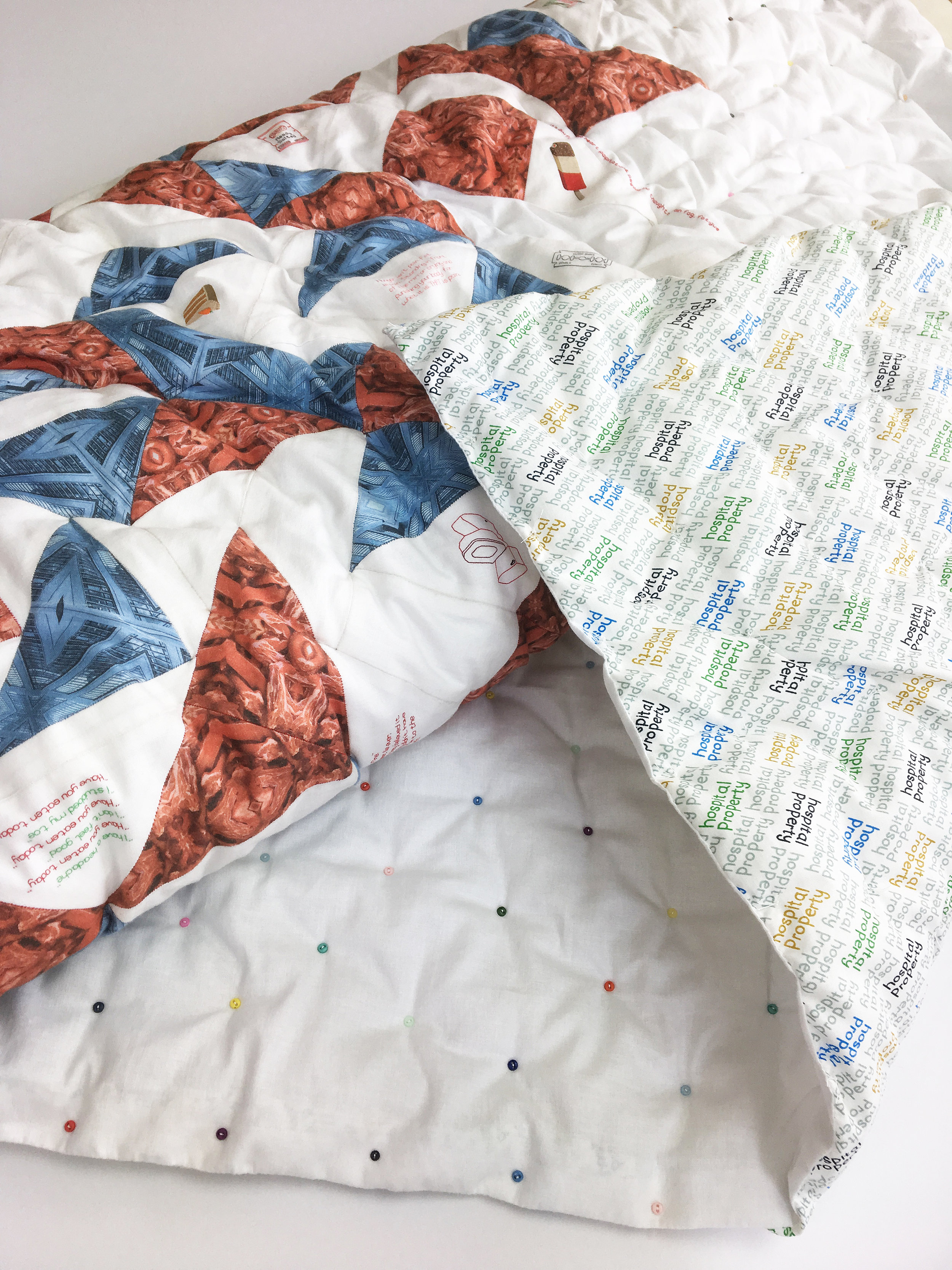 The backing of this quilt has been made using three hospital gowns
