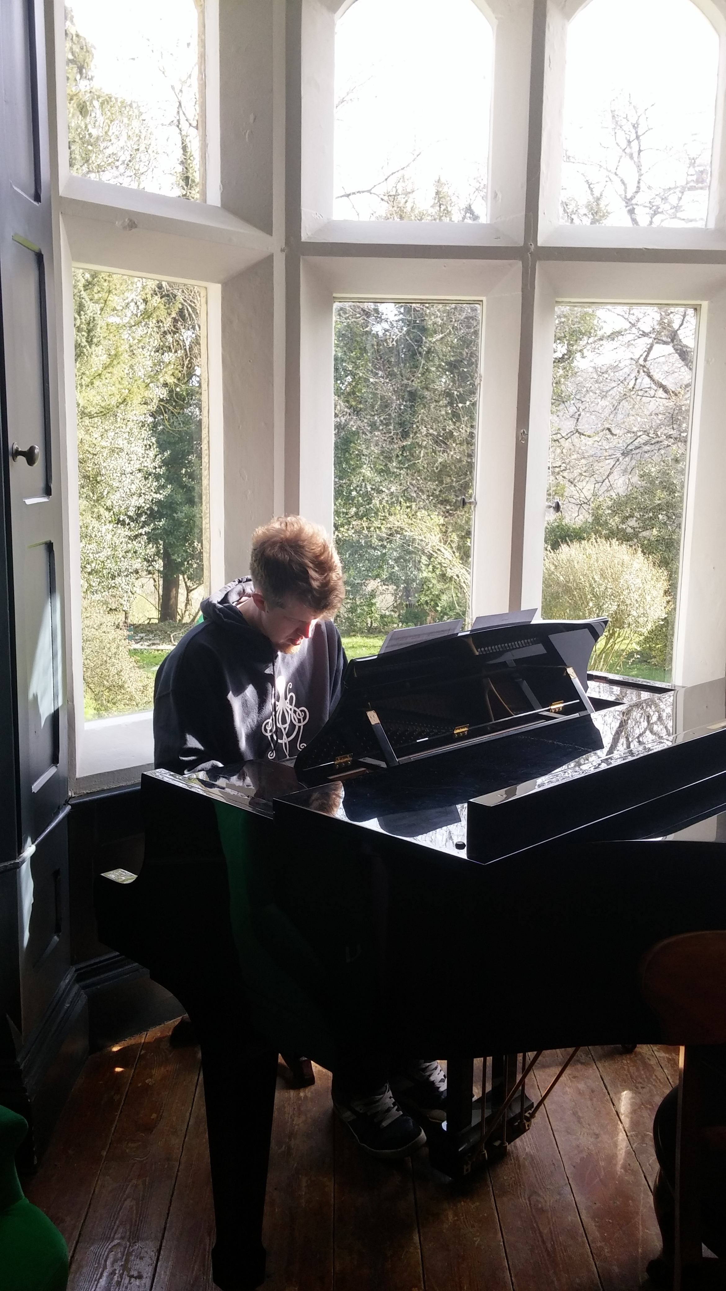 Graham playing piano at The Convent near Stroud