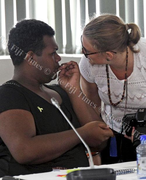 Amasai Jeke, left, of the Haus of Khameleon with Ellie van Baaren (UN Women rep) at the Violence Against Women training workshop in Suva yesterday. Picture: ELIKI NUKUTABU