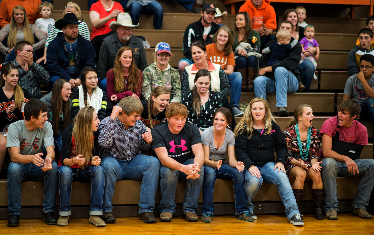 Homecoming week begins with a dinner (open to the public, $5 for a full plate of food, a beverage and dessert), followed by an auction held by Future Farmers of America and, finally, the crowning of the homecoming court. Riley Collier, center, looks stunned as students around him react to his junior attendant announcement. The high school gym can hold the entire town, and then some.
