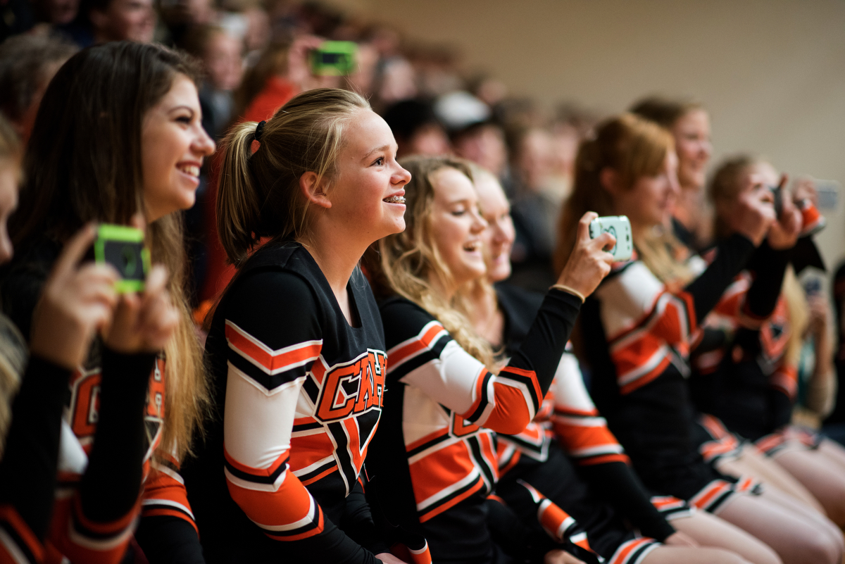 Cheerleaders Lesli Schneider, Tati Jones and Julia Habsburg watch the football players' skits from the stands during the pep rally.