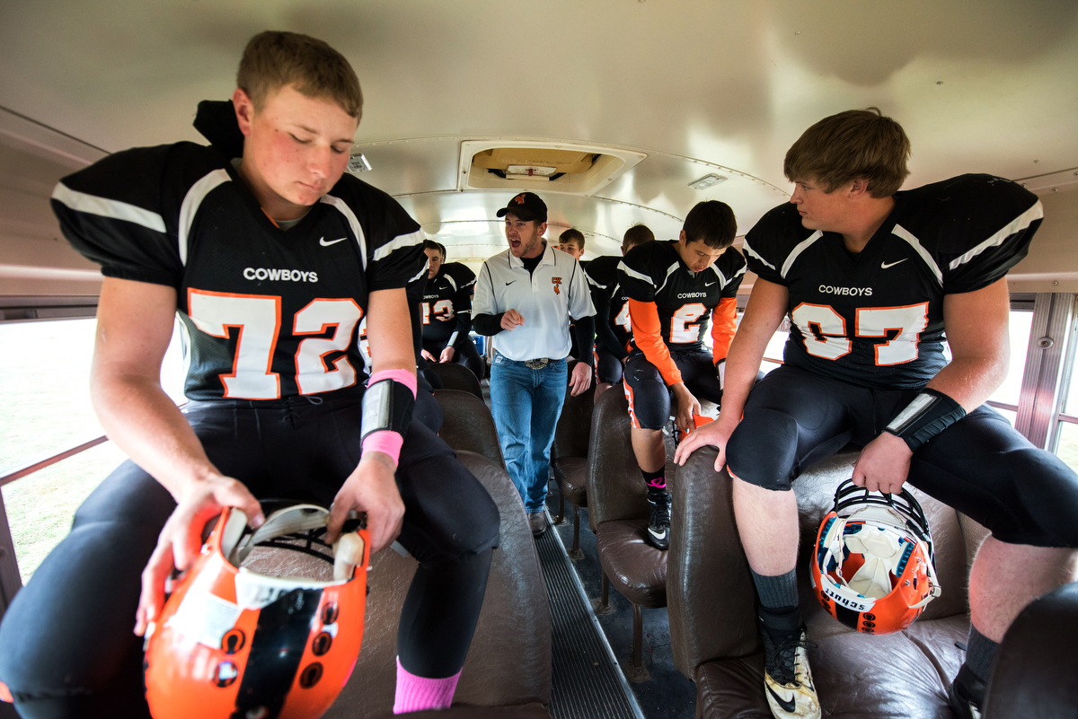 The team takes a bus from the high school to the football field across town. The trip is less than a mile, but Miller uses the time to give a short pep talk before games.