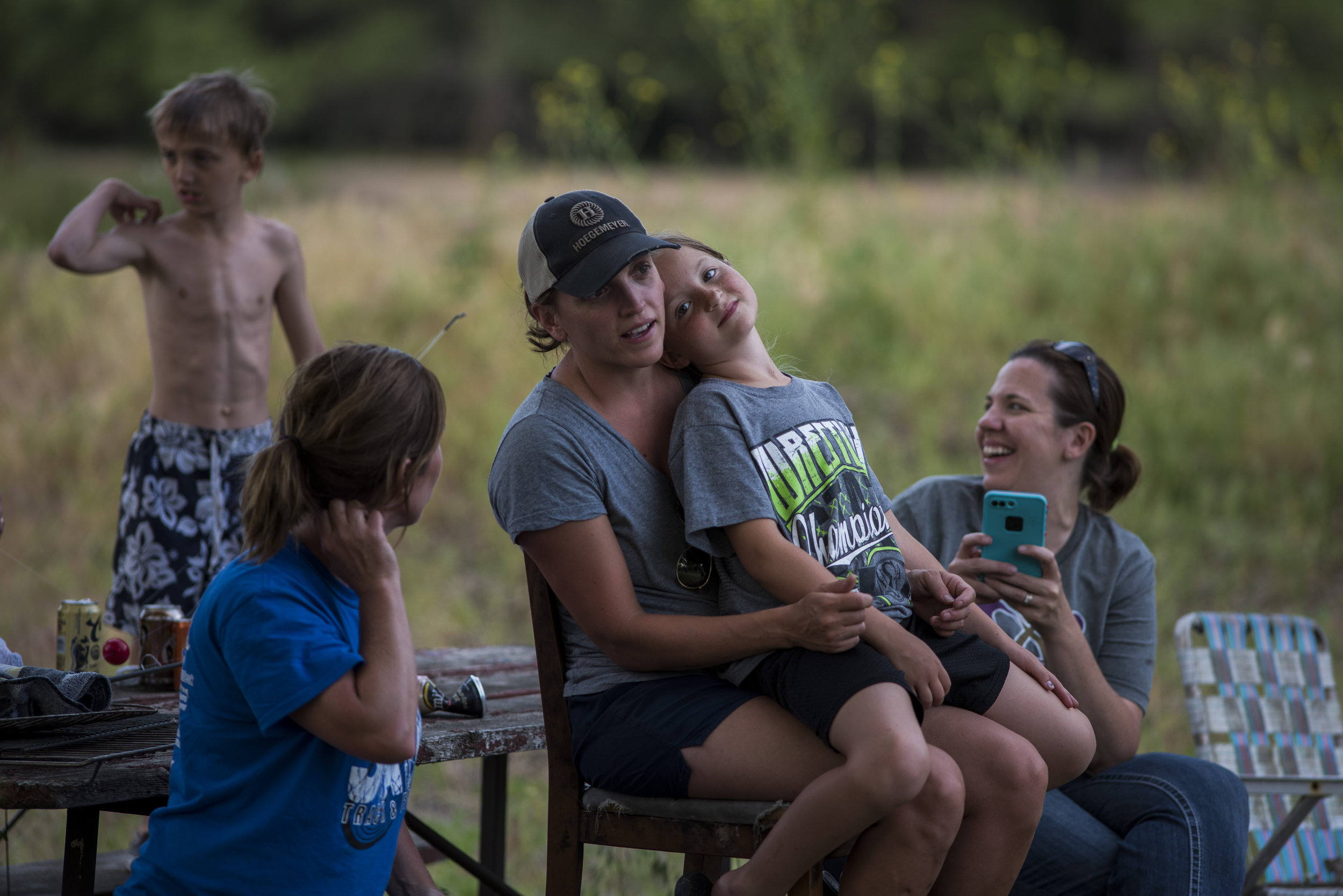 Family gathered for fishing, swimming and s'mores after a family picnic on the Elkhorn River.