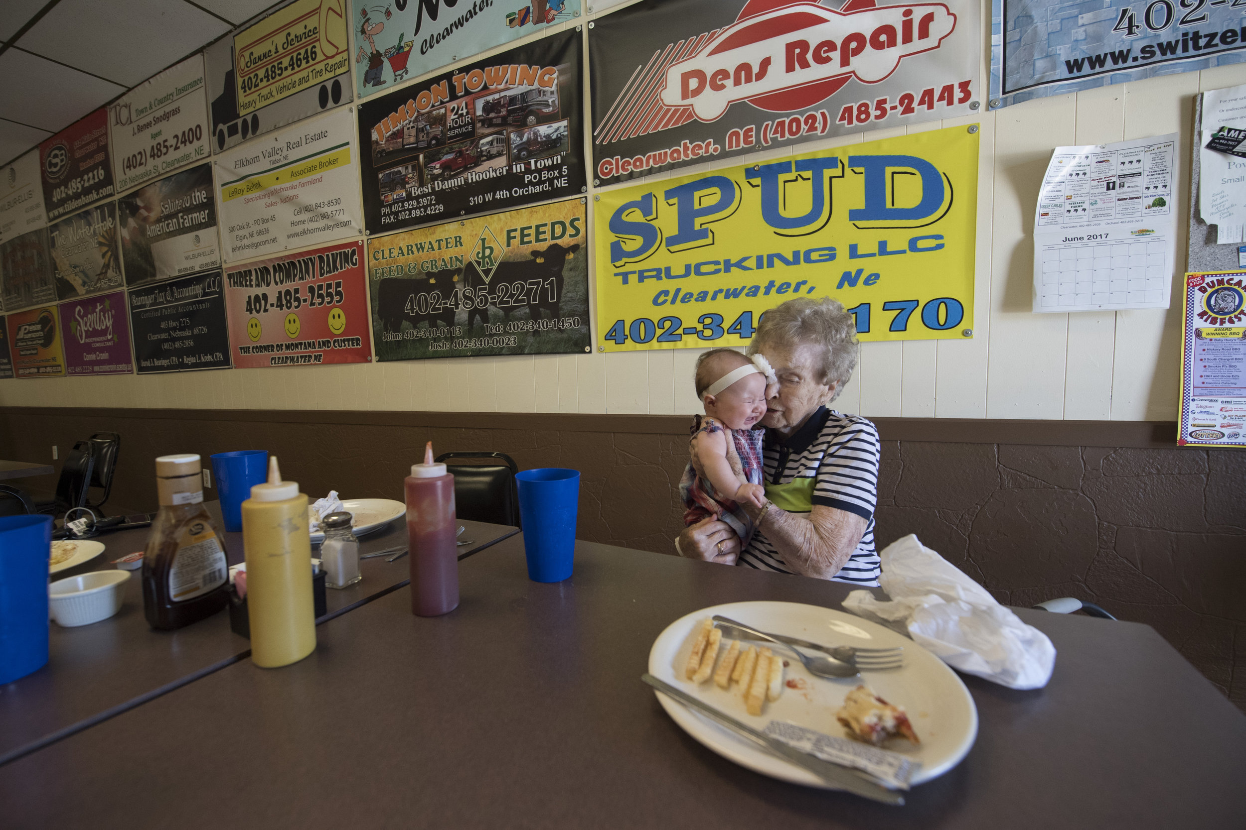 Lucille comforts her 100th great grandchild, Kinley Roemmich, at lunch at the Clearwater Cafe.