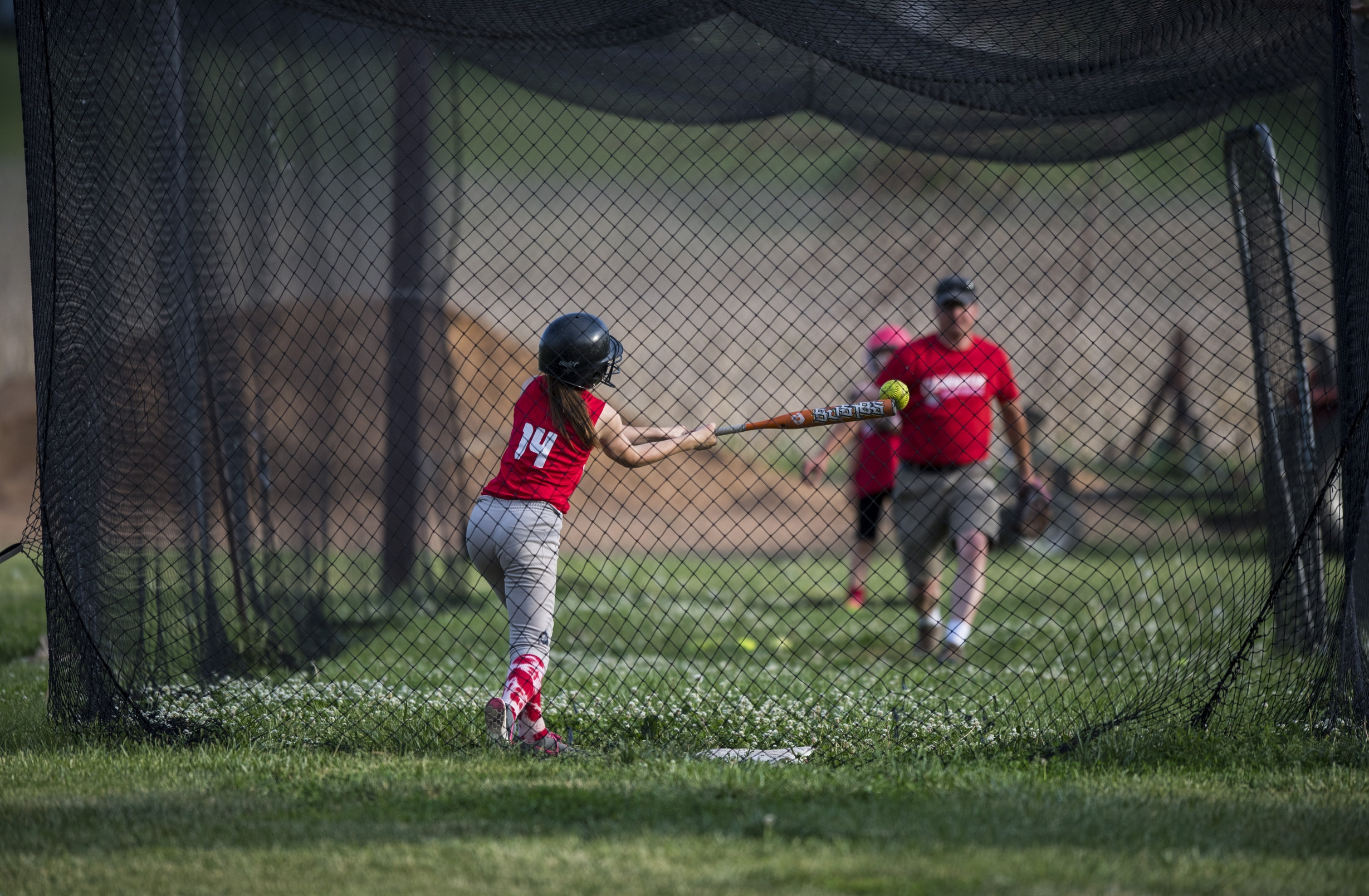 Grandson Timmy Kester pitches a practice ball to great granddaughter Cassidy Bearinger before a softball game.